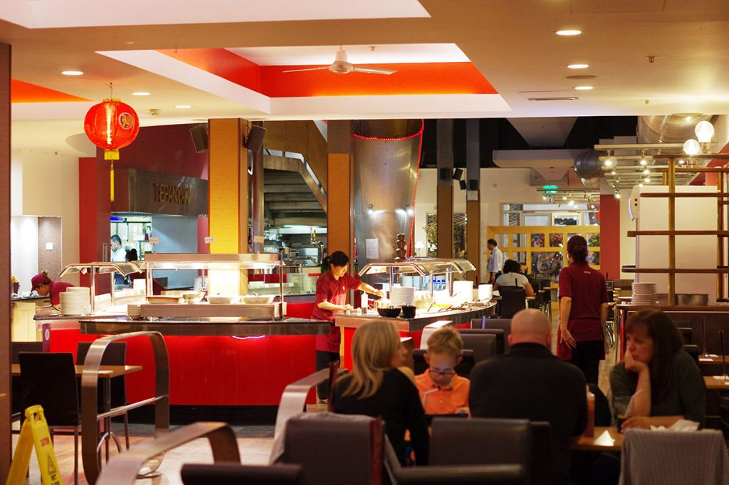 View of the buffet and seating area inside Aroma restaurant